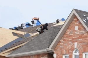 A photo of men repairing a roof